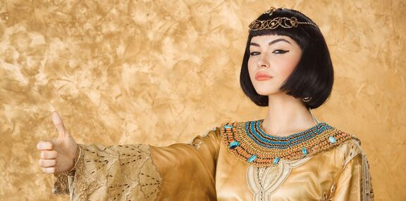 woman model with bright makeup with gold jewelery