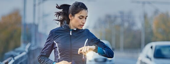 A woman running a 10k race