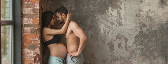 A woman having sex while pregnant